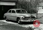 Image of family showing Lincoln-Mercury car Long Island New York USA, 1949, second 2 stock footage video 65675024712