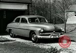 Image of family showing Lincoln-Mercury car Long Island New York USA, 1949, second 3 stock footage video 65675024712