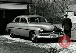 Image of family showing Lincoln-Mercury car Long Island New York USA, 1949, second 8 stock footage video 65675024712