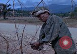 Image of barracks under construction Vietnam, 1965, second 11 stock footage video 65675024800