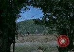 Image of dump trucks Vietnam, 1965, second 2 stock footage video 65675024801