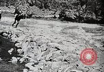 Image of long boats navigate rapids Japan, 1898, second 3 stock footage video 65675024930