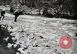 Image of long boats navigate rapids Japan, 1898, second 4 stock footage video 65675024930