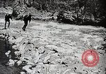 Image of long boats navigate rapids Japan, 1898, second 5 stock footage video 65675024930