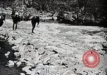 Image of long boats navigate rapids Japan, 1898, second 6 stock footage video 65675024930