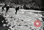 Image of long boats navigate rapids Japan, 1898, second 7 stock footage video 65675024930