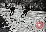 Image of long boats navigate rapids Japan, 1898, second 9 stock footage video 65675024930
