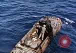 Image of U.S. wounded transported by boat from Okinawa battlefield Pacific Ocean, 1945, second 11 stock footage video 65675024978