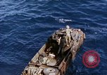 Image of U.S. wounded transported by boat from Okinawa battlefield Pacific Ocean, 1945, second 12 stock footage video 65675024978