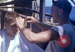 Image of U.S. sailor getting a haircut aboard his ship in Pacific Ocean Pacific Ocean, 1945, second 2 stock footage video 65675024980