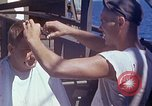Image of U.S. sailor getting a haircut aboard his ship in Pacific Ocean Pacific Ocean, 1945, second 3 stock footage video 65675024980