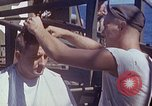 Image of U.S. sailor getting a haircut aboard his ship in Pacific Ocean Pacific Ocean, 1945, second 4 stock footage video 65675024980