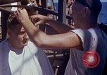 Image of U.S. sailor getting a haircut aboard his ship in Pacific Ocean Pacific Ocean, 1945, second 5 stock footage video 65675024980