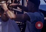 Image of U.S. sailor getting a haircut aboard his ship in Pacific Ocean Pacific Ocean, 1945, second 6 stock footage video 65675024980