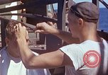 Image of U.S. sailor getting a haircut aboard his ship in Pacific Ocean Pacific Ocean, 1945, second 9 stock footage video 65675024980
