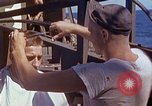 Image of U.S. sailor getting a haircut aboard his ship in Pacific Ocean Pacific Ocean, 1945, second 12 stock footage video 65675024980