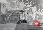 Image of Chinese Eastern Railway flag over train station Harbin Manchukuo, 1932, second 9 stock footage video 65675025073