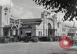 Image of Chinese Eastern Railway flag over train station Harbin Manchukuo, 1932, second 10 stock footage video 65675025073