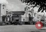 Image of Chinese Eastern Railway flag over train station Harbin Manchukuo, 1932, second 11 stock footage video 65675025073