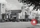 Image of Chinese Eastern Railway flag over train station Harbin Manchukuo, 1932, second 12 stock footage video 65675025073
