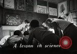 Image of Students doing assembly work Japan, 1945, second 2 stock footage video 65675025079