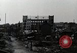 Image of Japanese citizens tear down air raid shelters Tokyo Japan Shiba district, 1945, second 4 stock footage video 65675025162
