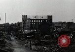 Image of Japanese citizens tear down air raid shelters Tokyo Japan Shiba district, 1945, second 9 stock footage video 65675025162