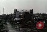 Image of Japanese citizens tear down air raid shelters Tokyo Japan Shiba district, 1945, second 10 stock footage video 65675025162