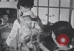Image of Family makes an excursion to cherry blossom festival Japan, 1940, second 5 stock footage video 65675025255