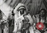 Image of Native American Indian Chief Aims Back introduces himself Fort Browning Montana USA, 1930, second 8 stock footage video 65675025292