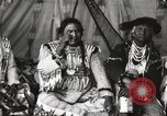 Image of Native American Indian Chief Short Face Introduces himself Fort Browning Montana USA, 1930, second 8 stock footage video 65675025293