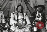 Image of Native American Indian Chief Short Face Introduces himself Fort Browning Montana USA, 1930, second 9 stock footage video 65675025293