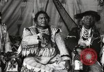 Image of Native American Indian Chief Short Face Introduces himself Fort Browning Montana USA, 1930, second 11 stock footage video 65675025293