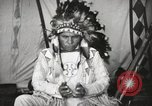 Image of Native American Indian Chief Drags Wolf introduces himself Fort Browning Montana USA, 1930, second 9 stock footage video 65675025296