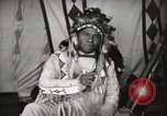 Image of Native American Indian Chief Drags Wolf introduces himself Fort Browning Montana USA, 1930, second 11 stock footage video 65675025296