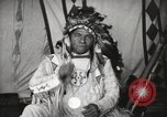 Image of Native American Indian Chief Drags Wolf introduces himself Fort Browning Montana USA, 1930, second 12 stock footage video 65675025296