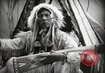 Image of Native American Indian Assinniboine Chief Rides Black Horse Fort Browning Montana USA, 1930, second 7 stock footage video 65675025306
