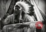Image of Native American Indian Assinniboine Chief Rides Black Horse Fort Browning Montana USA, 1930, second 9 stock footage video 65675025306