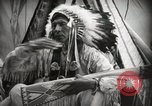 Image of Native American Indian Assinniboine Chief Rides Black Horse Fort Browning Montana USA, 1930, second 10 stock footage video 65675025306