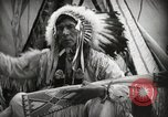 Image of Native American Indian Assinniboine Chief Rides Black Horse Fort Browning Montana USA, 1930, second 11 stock footage video 65675025306