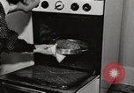 Image of Working American Women at home New York United States USA, 1950, second 3 stock footage video 65675025320