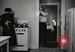 Image of Working American Women at home New York United States USA, 1950, second 8 stock footage video 65675025320