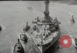 Image of USS Arkansas (BB-33) surrounded by tug boats New York City USA, 1915, second 5 stock footage video 65675025329