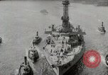 Image of USS Arkansas (BB-33) surrounded by tug boats New York City USA, 1915, second 6 stock footage video 65675025329