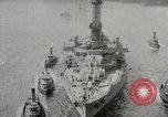 Image of USS Arkansas (BB-33) surrounded by tug boats New York City USA, 1915, second 7 stock footage video 65675025329
