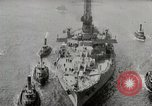Image of USS Arkansas (BB-33) surrounded by tug boats New York City USA, 1915, second 8 stock footage video 65675025329