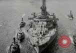 Image of USS Arkansas (BB-33) surrounded by tug boats New York City USA, 1915, second 9 stock footage video 65675025329