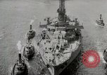 Image of USS Arkansas (BB-33) surrounded by tug boats New York City USA, 1915, second 10 stock footage video 65675025329