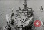 Image of USS Arkansas (BB-33) surrounded by tug boats New York City USA, 1915, second 11 stock footage video 65675025329