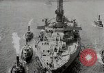 Image of USS Arkansas (BB-33) surrounded by tug boats New York City USA, 1915, second 12 stock footage video 65675025329
